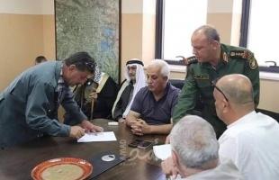 """بعد أيام من الشجار.. توقيع اتفاق هدنة ملزمة بين عائلتي """"الرجبي والجمل"""" في الخليل"""