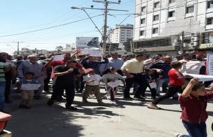 """غزّة: أصحاب """"البسطات"""" و""""الأسواق الشعبية"""" يعتصمون للمطالبة بإعادة فتحها  -صور"""