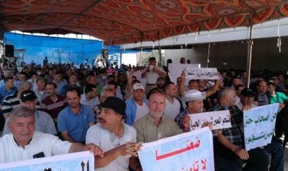 وقفة لتجار غزة احتجاجاً على استمرار الحصار واغلاق المعابر- صور